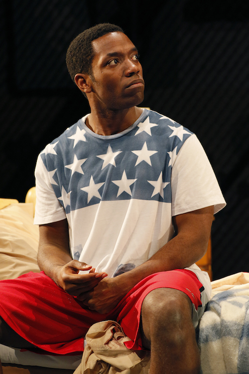"Chinaza Uche in ""brownsville song (b-side for tray)"" at Seattle Repertory Theatre. Photo by Chris Bennion."