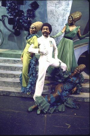 "Actor André De Shields (C) w. cast in a scene fr. the Broadway musical ""The Wiz"". (c.1974) Photo by Martha Swope courtesy of THE NEW YORK PUBLIC LIBRARY DIGITAL COLLECTIONS"