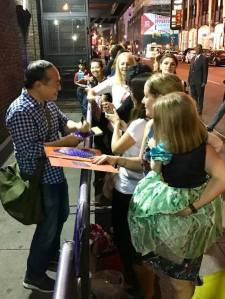 Alan Muraoka signing autographs at the stage door of Broadway's ALADDIN. Photo courtesy of Alan Muraoka