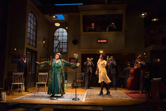"Arnetia Walker (Ma Rainey, in green dress) and Chanté Adams (Dussie May, in yellow dress), center, perform ""Ma Rainey's Black Bottom"" with members of the Company in August Wilson's Ma Rainey's Black Bottom at Two River Theater. Photo by T. Charles Erickson"