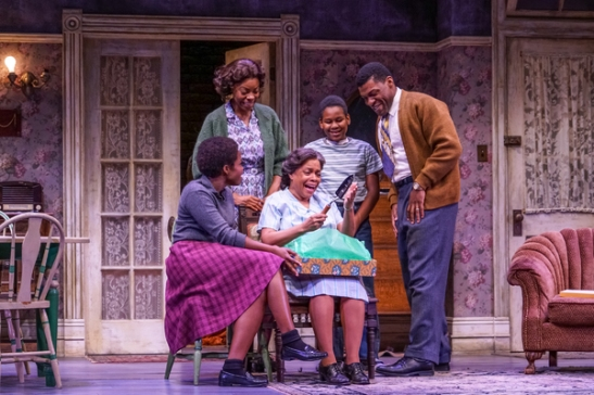 Claudine Mboligikpelani Nako (Beneatha Younger), Mia Ellis (Ruth Younger), Denise Burse (Lena Younger), Catalino Manalang (Travis Younger), Richard Prioleau (Walter Lee) in A Raisin in the Sun at Seattle Repertory Theatre. Photo credit: Alan Alabastro
