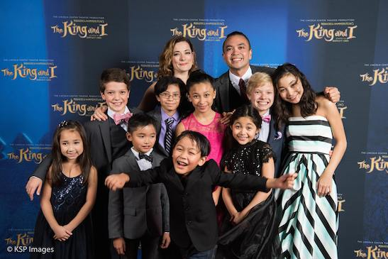 Laura Michelle Kelly and Jose Llana with the children of THE KING AND I. Photo by KSP Images